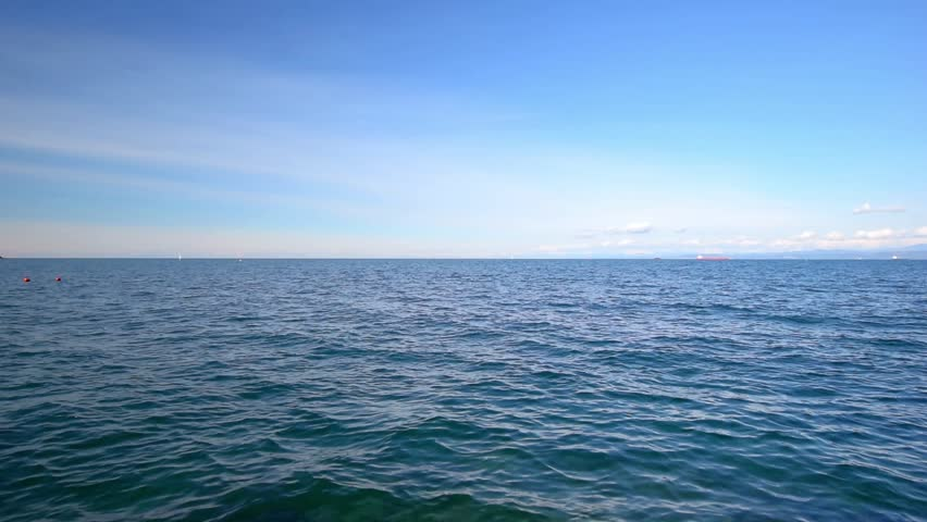 Sea, seascape, ocean, nature background. Idyllic seascape: clean water, waves, blue sky, horizon. Sea water surface, sea water texture, nature, resort, sea vacation full hd video background. #14666029