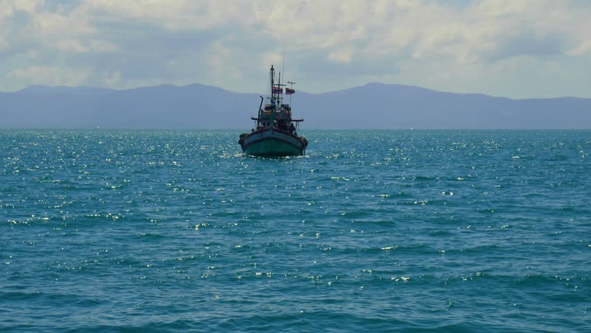 fishermen returning home, fishing boat with thai flags approaching shore in Thailand, 4k  (uhd 3840x2160, ultra high definition, 1920x1080, 1080p) - 4K stock footage clip