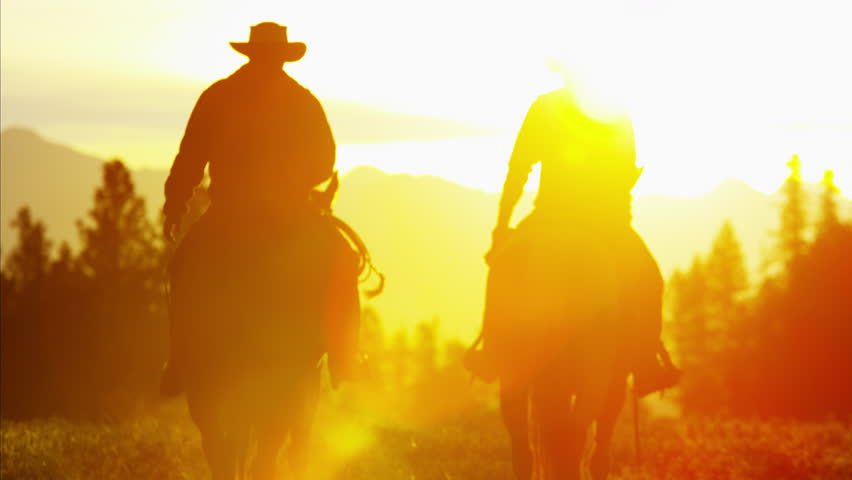 Silhouette of Cowboy Riders forest wilderness area Canada | Shutterstock HD Video #14724466