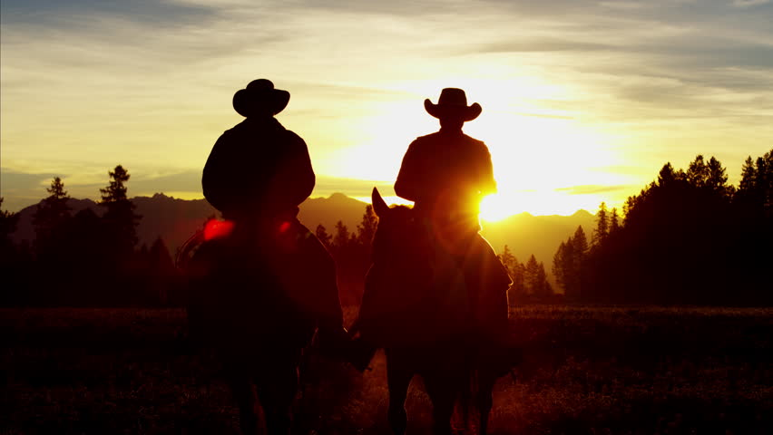 Silhouette of Cowboy Riders forest wilderness area Canada | Shutterstock HD Video #14724664