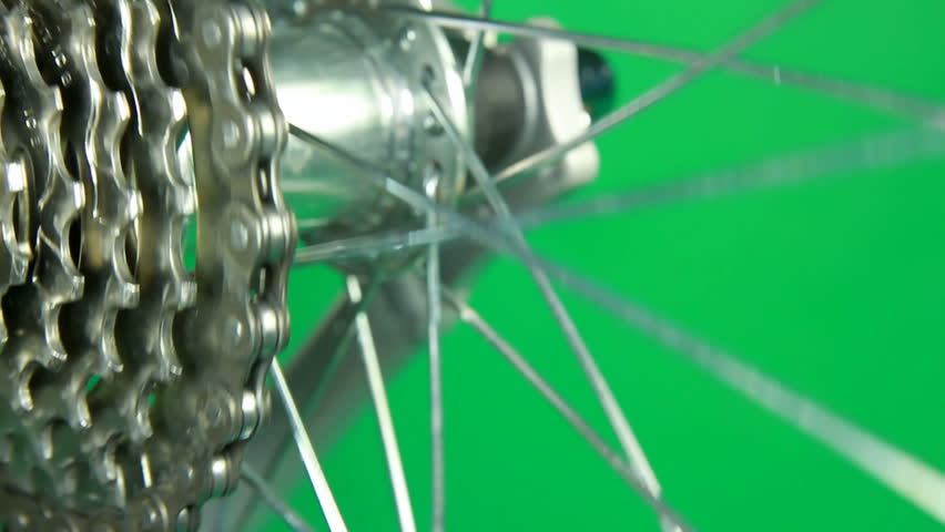 close up of hub wheel rotating with shift change gear on green screen - HD stock video clip