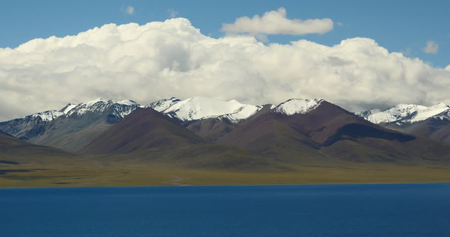 4k huge clouds mass rolling over lake namtso & Tanggula snow mountain peak,tibet mansarovar,Tibet's second largest lake,is the third largest saltwater lake in China.gh2_09328_4k