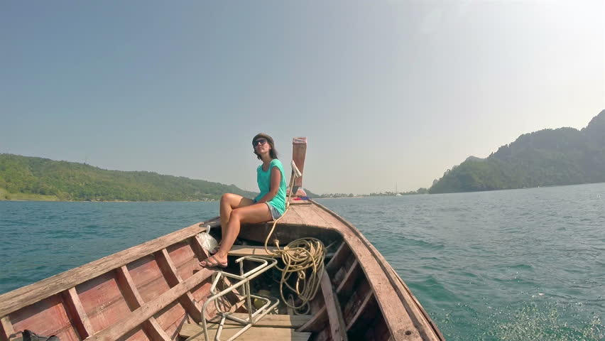 Girl on a board the boat floating in the sea - HD stock video clip
