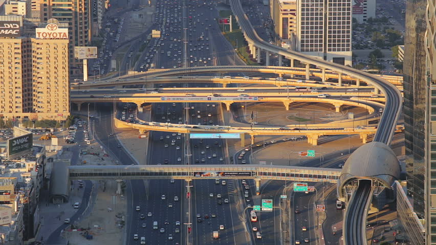 DUBAI, UAE - DECEMBER 19, 2015:  View of the famous Sheikh Zayed road intersection with moving traffic at sunset.  - HD stock video clip