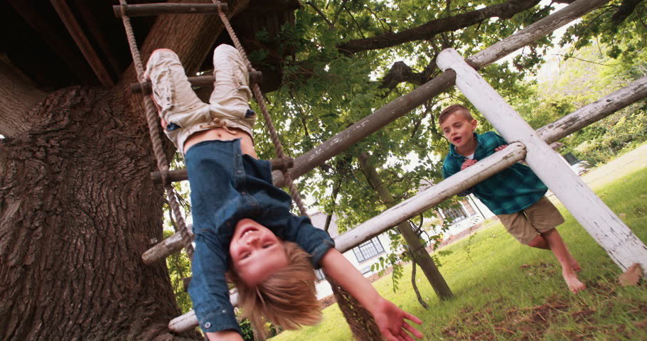 Girl Hanging Upside Down On Play Equipment Stock Footage ...