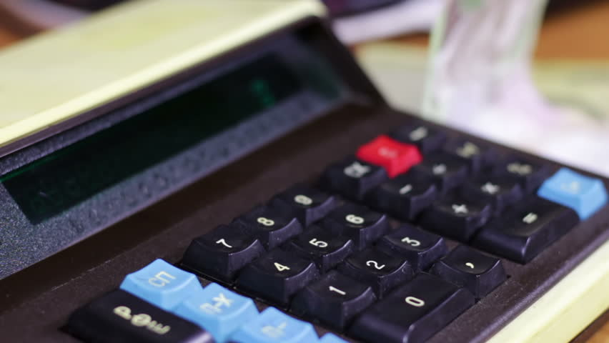 Counting Money On a Retro Calculator - HD stock footage clip