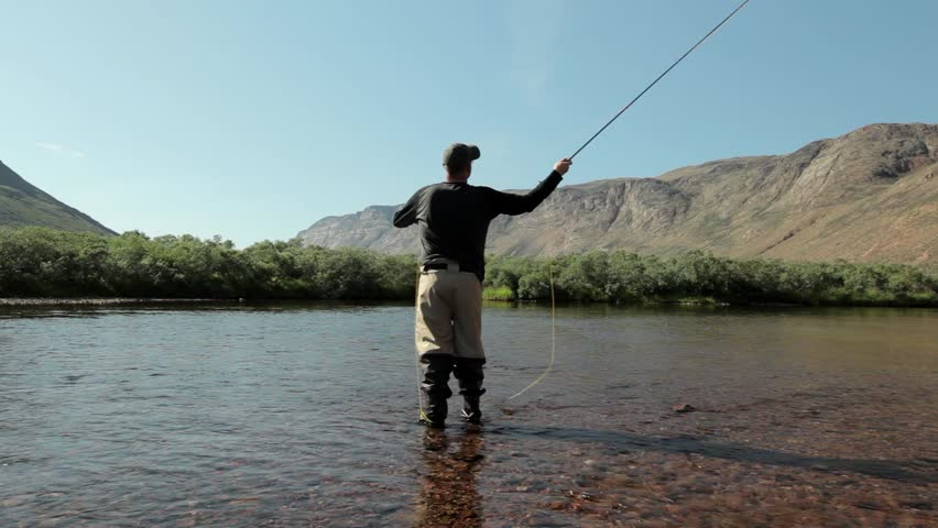 Boom shot of fly fishing in arctic river, Greenland