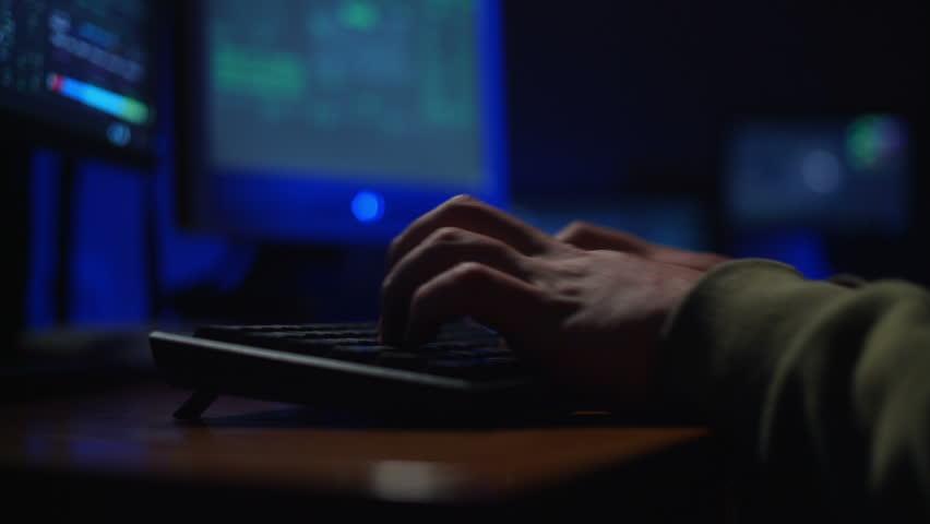 keyboard, a man hacker cracks a password - HD stock footage clip
