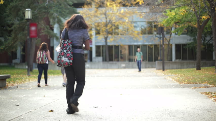 College student walking on a university campus.  | Shutterstock HD Video #1490857