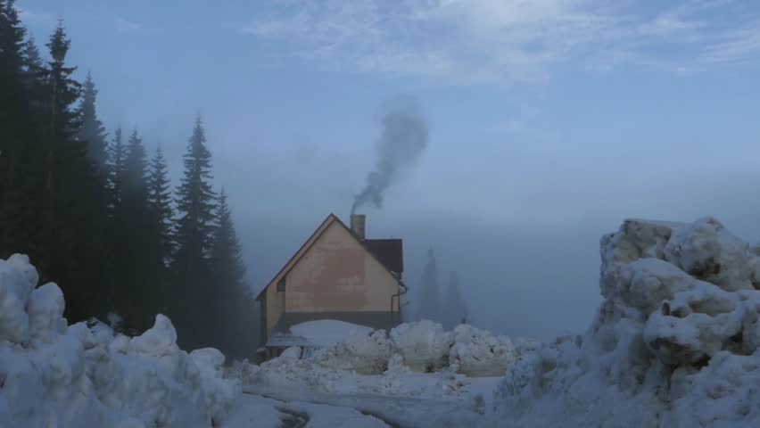 Smoke Flying Out From The Chimney Of A House In A Winter