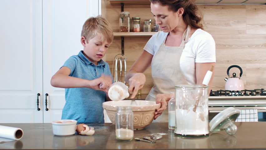 Mother And Son Making Pancake Batter In The Kitchen ...