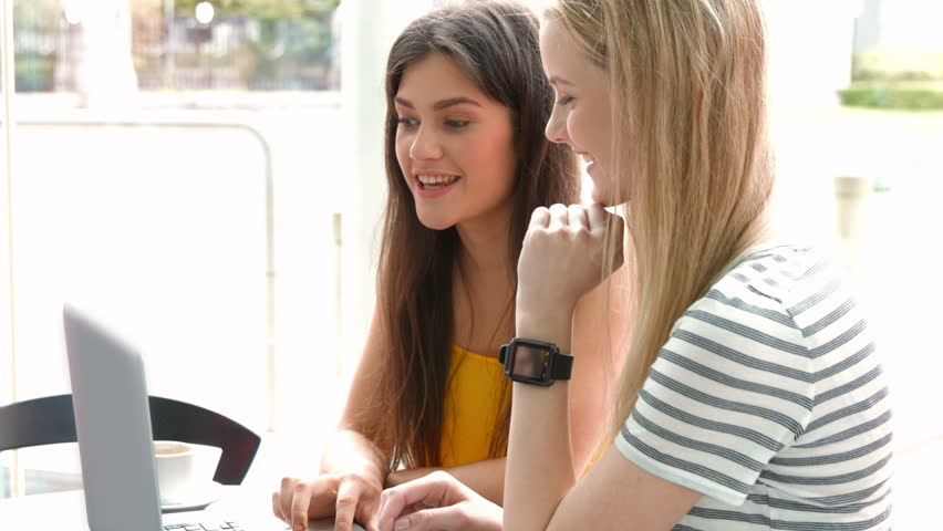 Students hanging out in campus cafe using laptop in high quality 4k format | Shutterstock HD Video #14925949