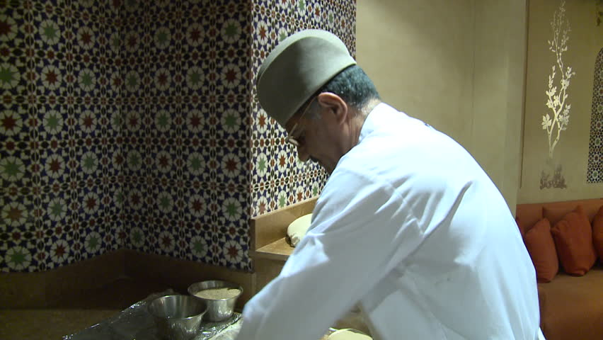Deira, Dubai - 2012 - Shot of a baker in a restaurant kneeding the dough of naan bread before placing it in a tandoor oven. - HD stock video clip