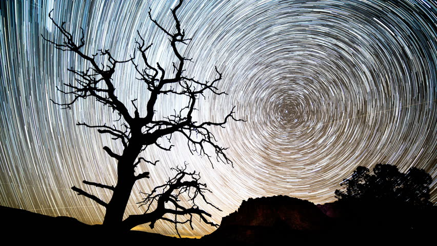 Time lapse of a star trail as if forms in the Utah desert of Capitol Reef.