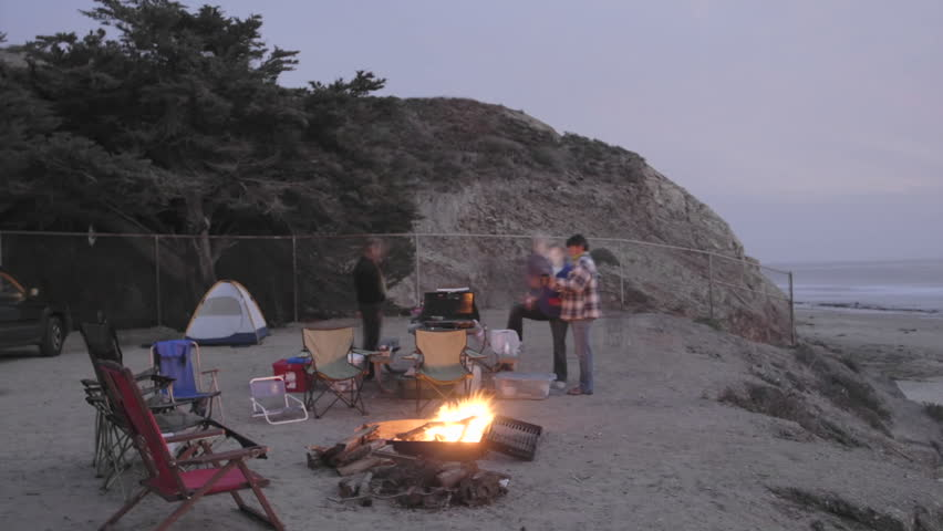 Time lapse of people around a campfire at Jalama Beach County Park, California. - HD stock video clip