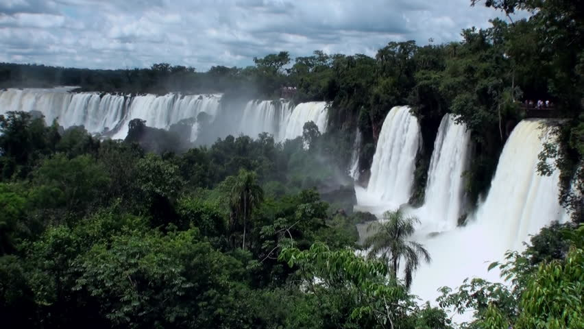Iguazu semicircular Falls National Park on border of Brazil and Argentina. Made up of many cascades producing vast sprays of water. Iguacu most spectacular waterfalls in world. Natural beauty. - HD stock video clip