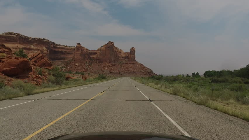 POV driving down scenic road in South West USA