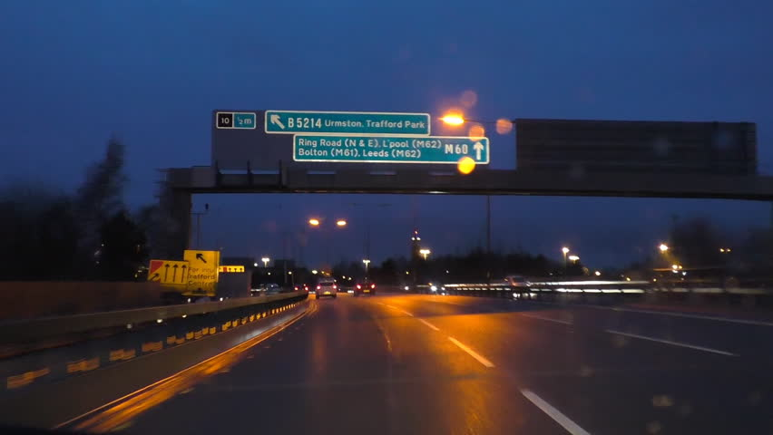 Driving at night on ring road M60 around Manchester near Trafford.Building smart motorway, speed restriction