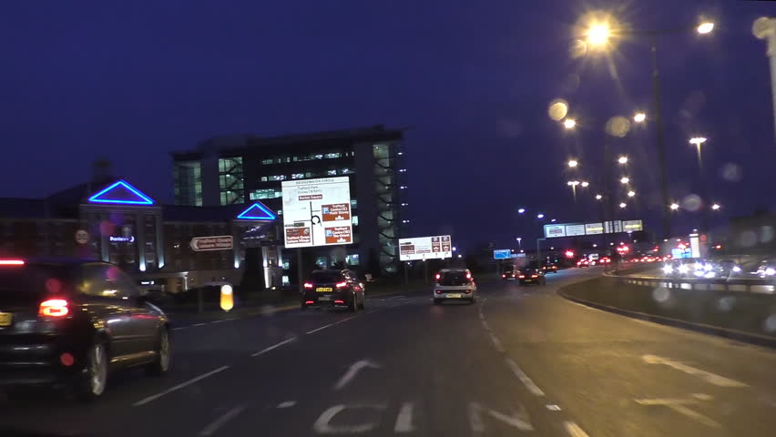 Driving at night near Trafford centre,Manchester city, England. Driver or windscreen view.