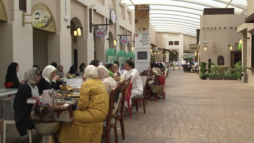 Kuwait close up of three veiled but modern