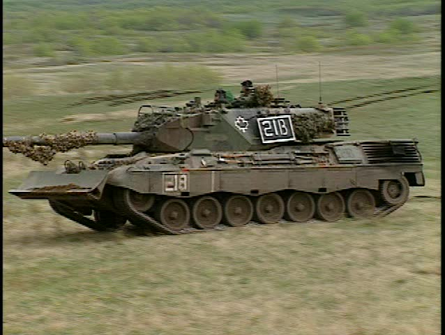 Leopard tank moves right to left (good audio) - SD stock footage clip