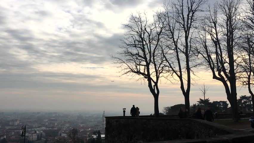 ?ITALY, BERGAMO - JANUARY 27, 2016: City Bergamo in Italy people observe landscape from the perimeter wall - HD stock video clip