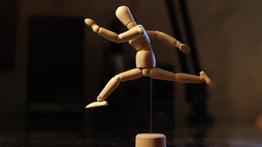 Animated wooden man looks at his hands and feet, then runs, stops to catch his breath. | Shutterstock HD Video #15082018