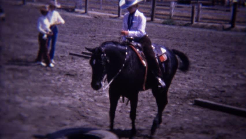 RIVERSIDE, CALIFORNIA 1967: Horsemanship dressage reining event stepping car tires. - 4K stock footage clip