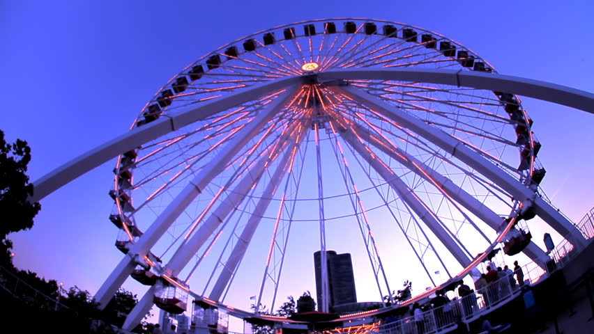 CHICAGO - CIRCA 2010: Ferris wheel lights at dusk at the Chicago Navy Pier, circa 2010 in Chicago.  - HD stock video clip