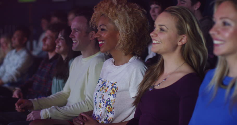 4K Theatre audience laughing at comedy show or funny movie