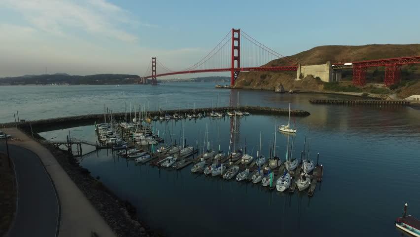 Boat marina and Golden Gate Bridge in San Fransisco, California, aerial shot