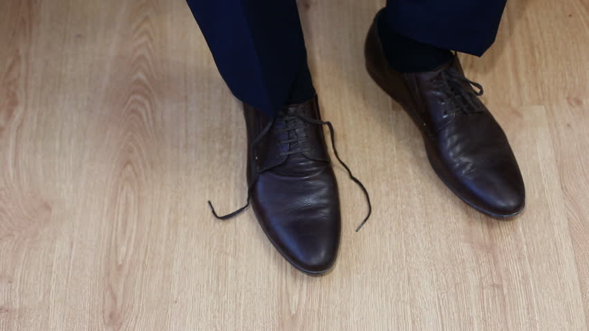 Man tying patent leather shoes formal and festive dressing. - HD stock footage clip