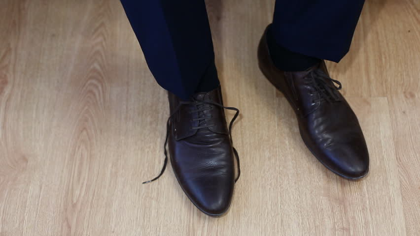 Man tying patent leather shoes formal and festive dressing. - HD stock video clip