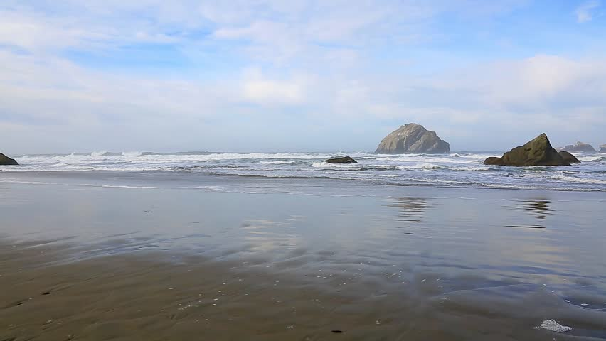 Seastacks in the Pacific Ocean from Bandon Beach in Bandon, Oregon - HD stock footage clip