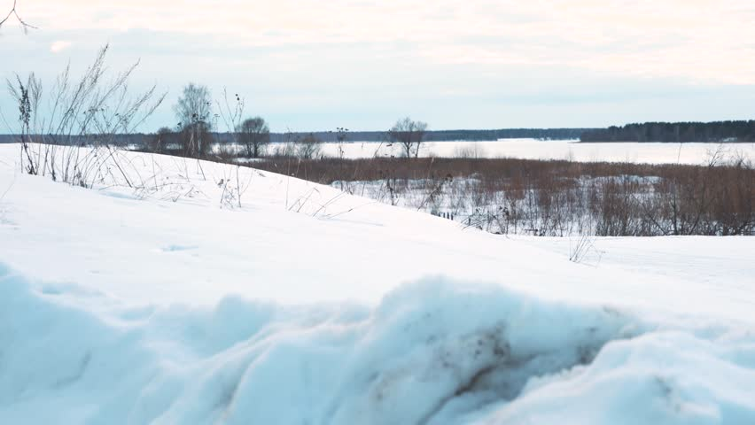 Young couple on snowmobile at sunny day - 4K stock video clip