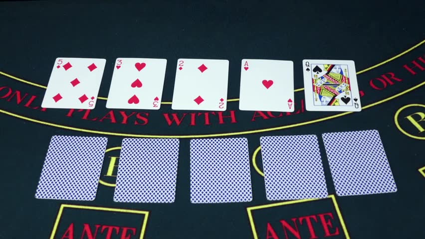 Croupie takes the poker cards on green table, slow motion | Shutterstock HD Video #15249895