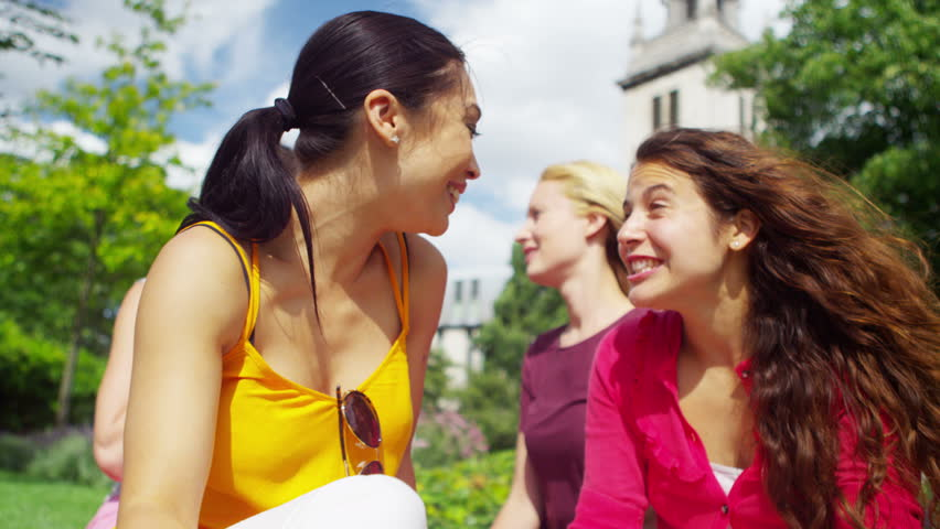 Two Jealous Women Fight For The Same Man In Park Stock Footage     Shutterstock  K Portrait of happy attractive female friends chatting in the park    K stock footage clip