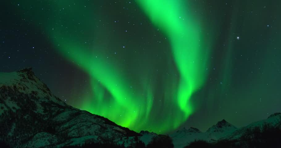 a short powerful aurora borealis dancing in the arctic