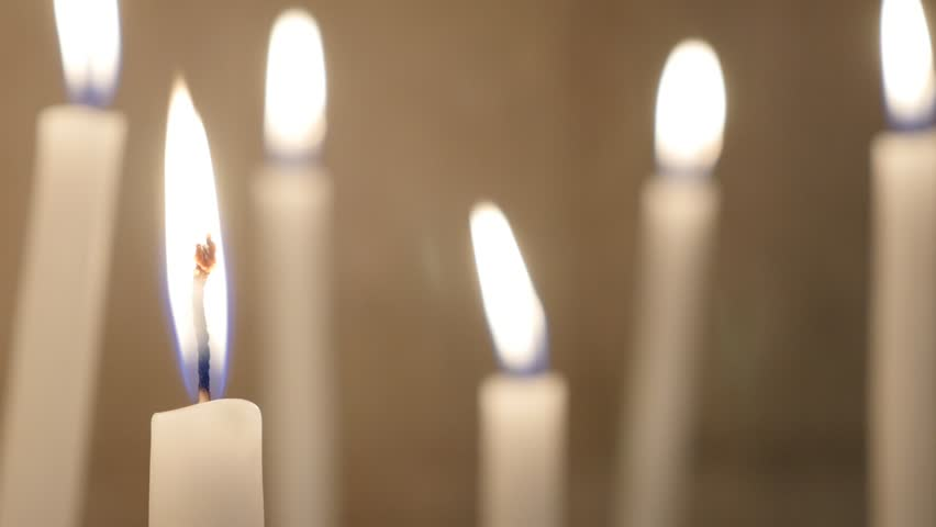Close Shot Of A White Candle Burning With Bright Candle