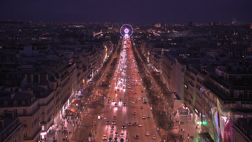 Aerial night view of Paris from the top of the Arc de Triomphe along the Champs Elysees boulevard towards the famous ferris wheel of the Place de la Concorde | Shutterstock HD Video #15323884