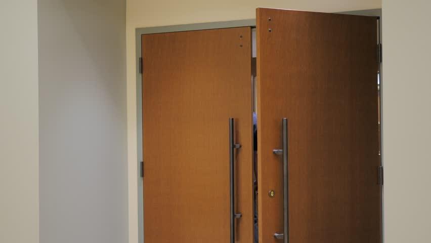 Large wooden door swings close