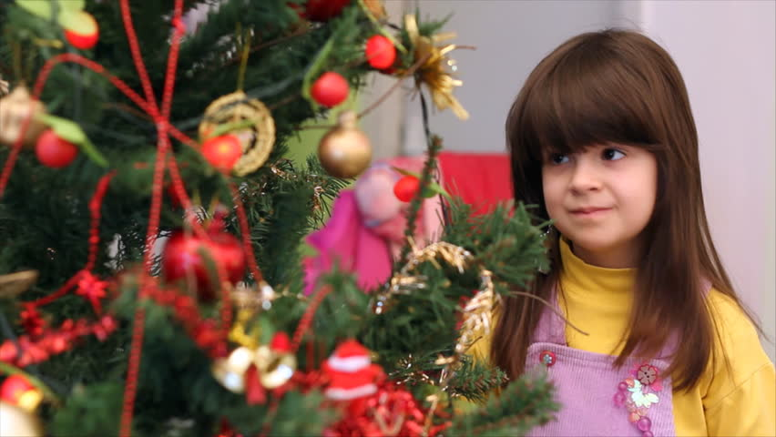 Girl decorating a Christmas tree - HD stock footage clip