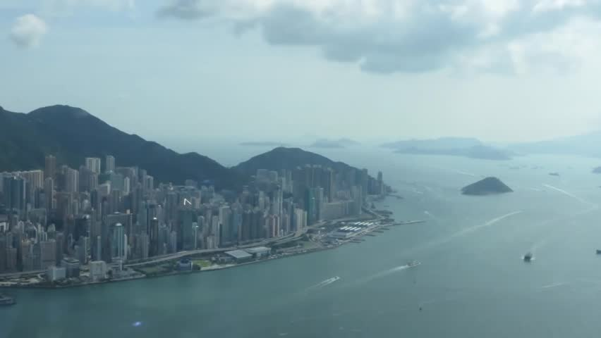 View of Hong Kong on the Bay. on the Shore Stand Tall Skyscrapers. For Water Float a Lot of Ships and Yachts. View of the City and Bay From the Bird's Flight. the Sky Floating Clouds of White. | Shutterstock HD Video #15443602