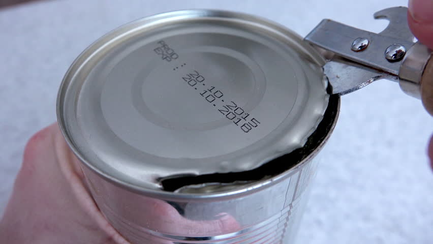 Close-up View of Man Opening Tin Can. 4K Ultra HD 3840x2160 Video Clip