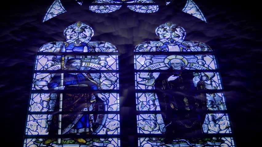 Abstract sun rays shining through stained glass windows. HD 1080i - HD stock footage clip