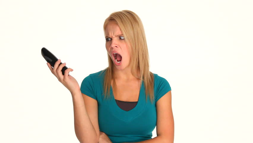 Angry, frustrated young blonde woman talking on a cordless phone.