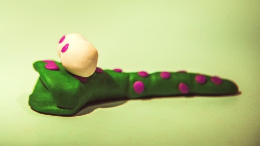 Plasticine animation. Greedy worm - HD stock footage clip