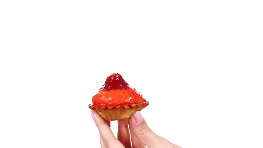 Woman hand holds strawberry cake cupcake. Weight loss dieting junk food concept. 4K ProRes HQ codec #15544249