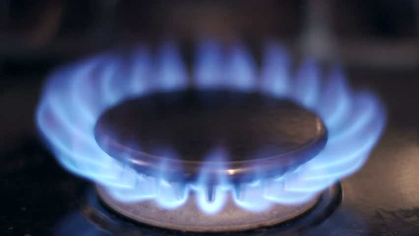 Stove top burner igniting into a blue cooking flame in 4K UHD. See my portfolio for other angles and slow motion speeds (60fps-180fps). - 4K stock footage clip