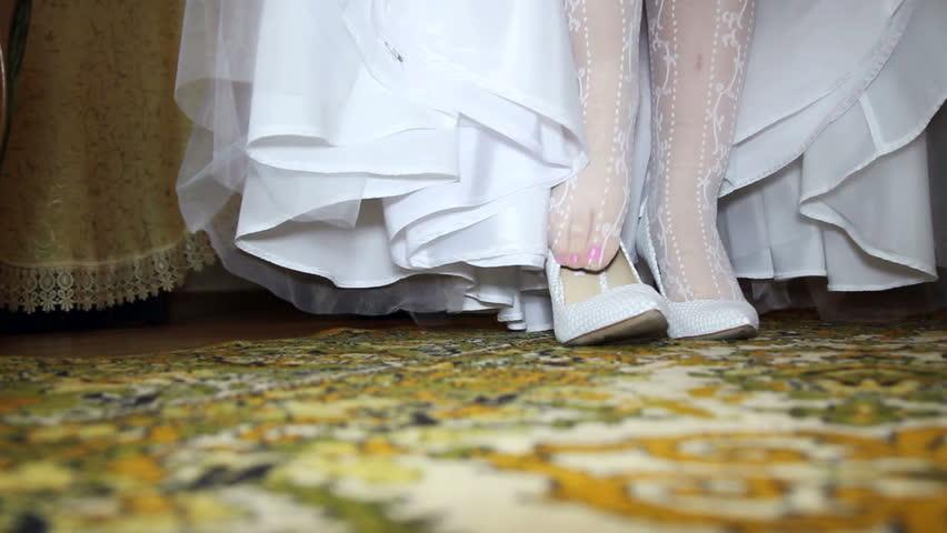 Bride dress white shoes close-up - HD stock video clip